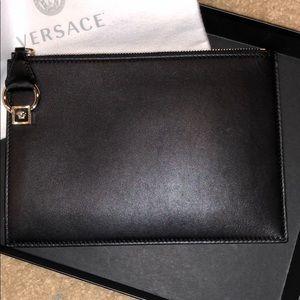 Genuine Versace black label.